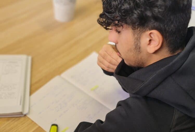 student thinking while studying